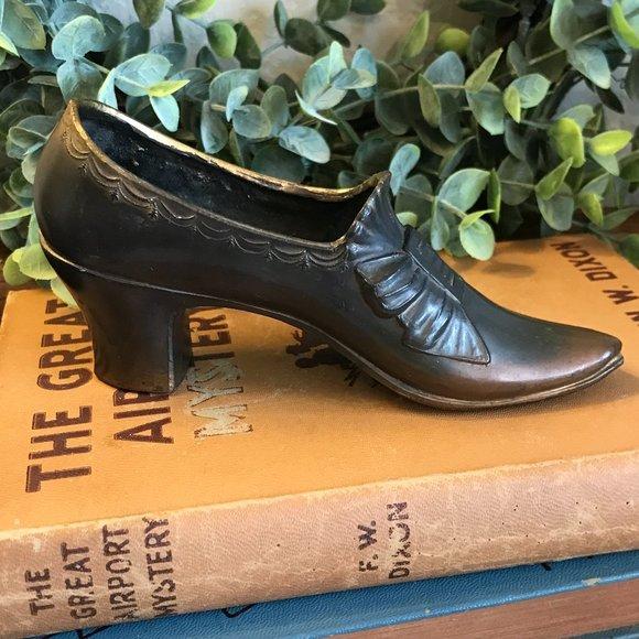 Vintage brass shoe